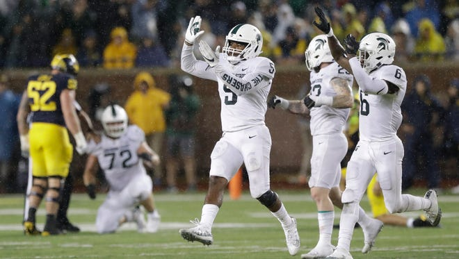 Michigan State LB Andrew Dowell (5) and S David Dowell (6) celebrate after an interception during the second half against Michigan at Michigan Stadium in Ann Arbor on Sat., Oct. 7, 2017.
