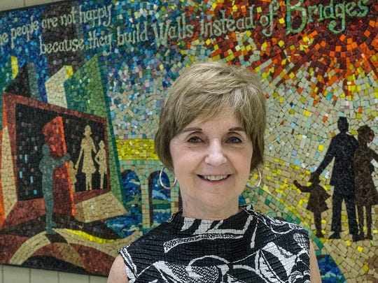 Carolyn Witte, near one of the school's iconic mosaics.