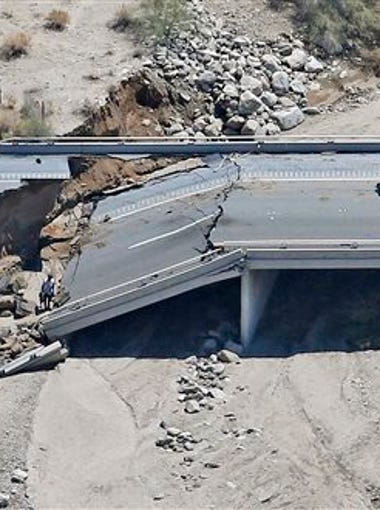 This aerial photo shows the collapsed elevated section of Interstate 10 Monday, July 20, 2015, in Desert Center, Calif. All traffic along one of the major highways connecting California and Arizona was blocked indefinitely when the bridge over a desert wash collapsed during a major storm, and the roadway in the opposite direction sustained severe damage.