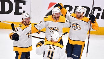 Nashville Predators defenseman Mattias Ekholm (14) celebrates his goal with center Colton Sissons (10), left, defenseman Ryan Ellis (4) foreground and left wing Austin Watson (51) during the first period of game 6 in the first round NHL Stanley Cup Playoffs at Pepsi Center, Sunday, April 22, 2018, in Denver, Colo.