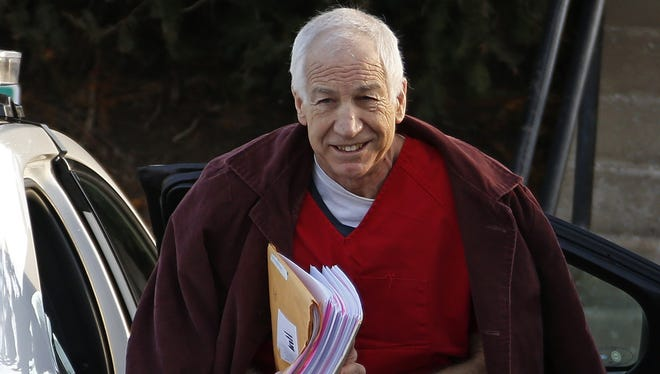Former Penn State assistant football coach Jerry Sandusky arrives at the Centre County Courthouse for a post-sentencing hearing in Bellefonte, Pa., on Jan. 10.