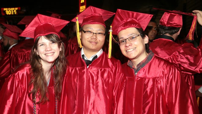 From left, Cate Martin, Seng Nguyen, and Killian Rodriguez pose for ap photo before the Edison High School graduation at Rutgers Athletic Center in Piscataway on June 22, 2016.