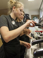 Staff works at the Lory Student Center Starbucks.