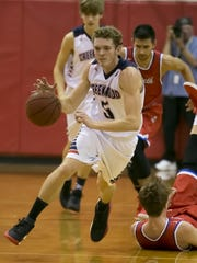 Left: Creek Wood's Clay Ruf breaks down the court against