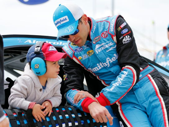 Aric Almirola talks to his son Alex prior to the Sprint