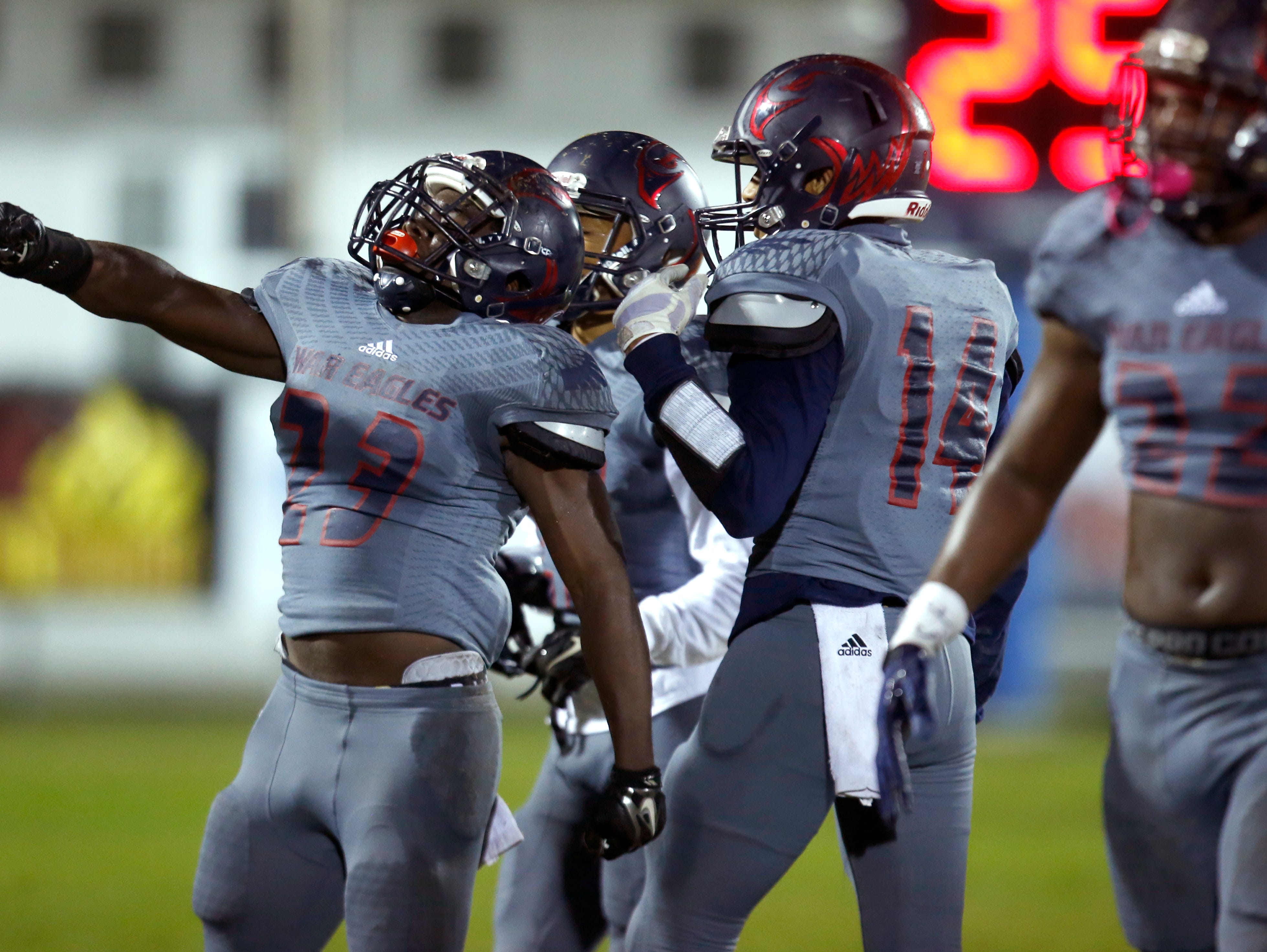 Wakulla's Antonio Morris celebrates after his team pressures Rickards quarterback into throwing an interception during their playoff game on Friday.
