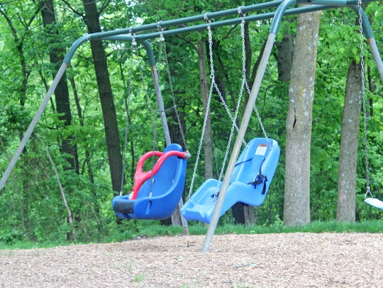 Disability-friendly swings seen at Shimek Elementary's