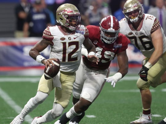 FSU's Deondre Francois scrambles out of the pocket