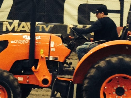 Tony Stewart operates a tractor at the River Spirit
