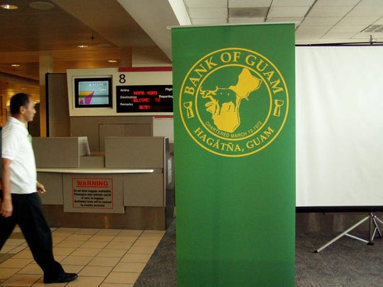 In this file photo, the Bank of Guam logo is displayed at the A.B. Won Pat Guam International Airport.