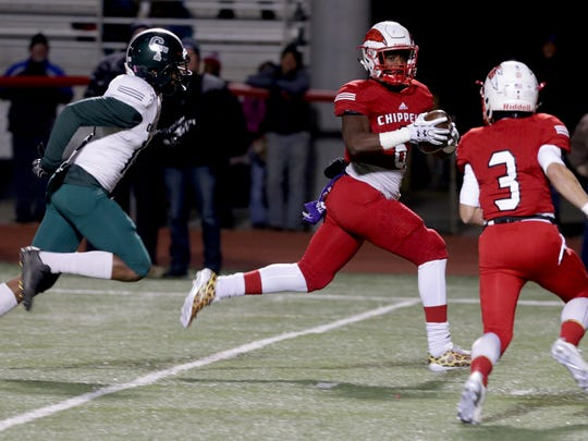 Clinton Twp. Chippewa Valley tight end Marcel Lewis runs to the end zone for the touchdown against Detroit Cass Tech on Nov. 10, 2017.