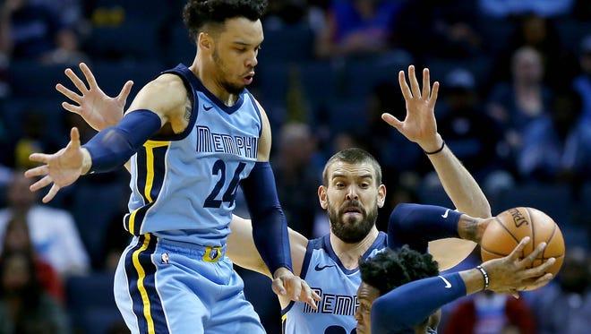 Memphis Grizzlies center Marc Gasol (33) and forward Dillon Brooks (24) put pressure Detroit Piston's forward Stanley Johnson during their NBA game Sunday April 8, 2018 at the FedExForum.