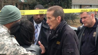 In this 2015 photo, Harrison County Coroner Gary Hargrove, center, discusses Harrison County Supervisor William Martin's death outside Martin's home in Gulfport, Miss.