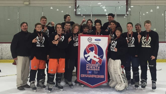 Team Warwick celebrates with their title banner after winning the Hockey Fights Cancer U16 Tournament.