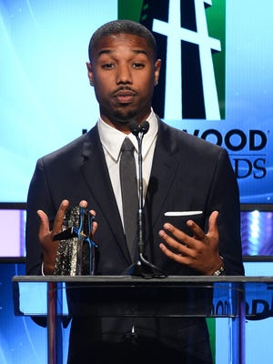 """Actor Michael B. Jordan accepts the Hollywood Spotlight Award for """"Fruitvale Station"""" on Oct. 21, 2013, in Beverly Hills, California."""