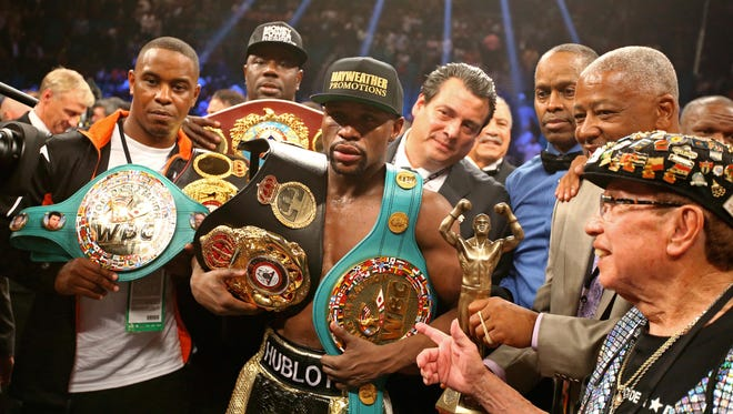 May 2, 2015: Floyd Mayweather Jr celebrates with the championship belts after defeating Manny Pacquiao (not pictured) after 12 rounds in a unanimous judges decision during a boxing fight at the MGM Grand Garden Arena.