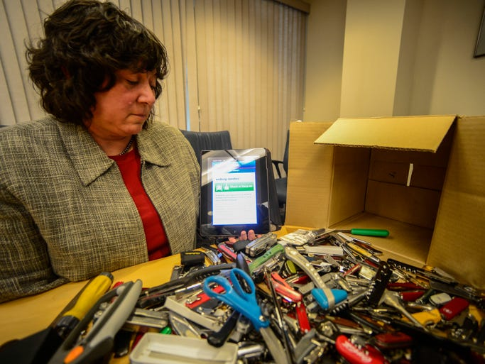 Lisa Farbstein, public affairs manager in the Office of Strategic Communication and Public Affairs for the TSA, shows how to use the TSA's app on approved items that can be brought onto a plane.