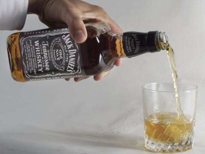 Jack Daniels and ice. Spirits maker Brown-Forman Corp. says its first-quarter net income rose 5 percent, led by strong growth for its flagship Jack Daniel's brand. The company behind such other brands as Southern Comfort, Finlandia and el Jimador says the performance was slowed by lower inventory levels by distributors. Last year, distributors stocked up ahead of larger price increases. For the quarter ending July 31, the company reported net income of $150 million, or 70 cents per share. That's up from $143 million, or 66 cents per share, a year ago. Net sales rose 3 percent to $921 million.
