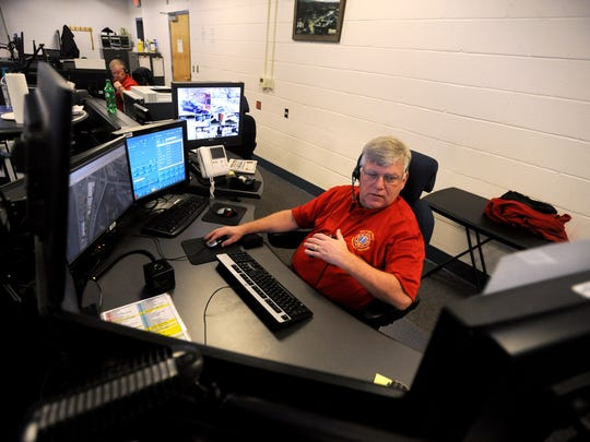 Dispatcher John Sparks assigns Emergency Medical Services to a 911 call Friday morning at the Buncombe County 911 Emergency Services Dispatch Center off Erwin Hills Road.