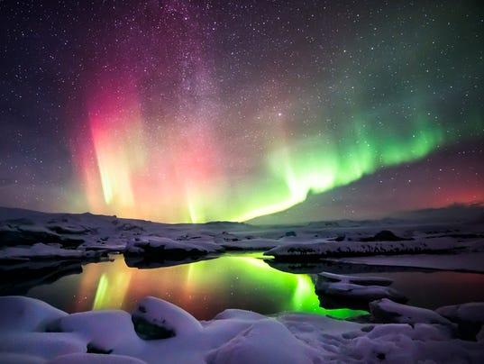 Mixed aurora dancing over the Jokulsarlon lagoon, Iceland