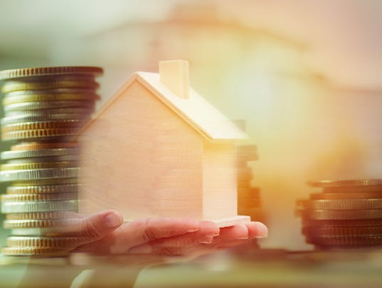 double exposure of coin and wood house, concept as buying, selling and mortgage home