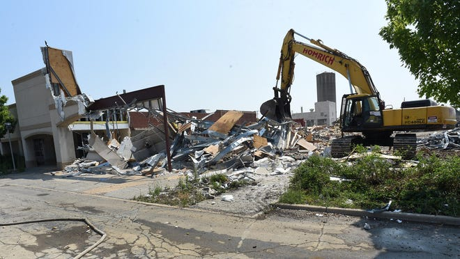 Progress is evident as Homrich demolition crews tear down the former La-Z-Boy headquarters off Telegraph Rd. in Monroe. Two elements of the site still may survive the ongoing demolition efforts, the old boiler house and silo.