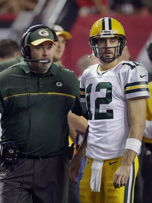 Green Bay Packers quarterback Aaron Rodgers and coach Mike McCarthy try to come up with a plan in the final minutes against the Atlanta Falcons at the Georgia Dome.