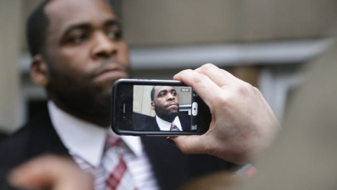 Former Detroit Mayor Kwame Kilpatrick exits the federal courthouse  on March 11, 2013, in downtown Detroit after the jury handed down a verdict in his public corruption trial. Kilpatrick was convicted on 24 of 30 counts, including five counts of extortion, racketeering, bribery and several mail, wire and tax fraud charges.
