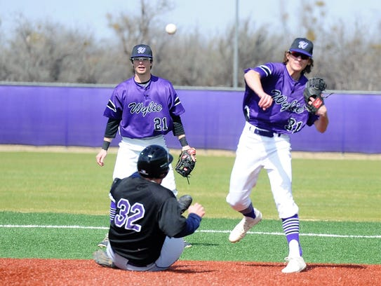 Wylie second baseman Tyler Martin (31) throws to first