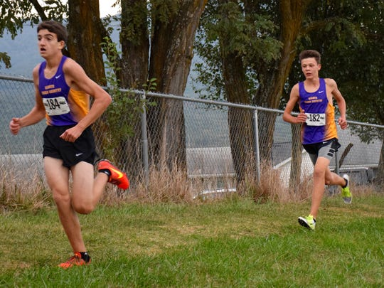 Waynesboro's Stuart Vailes, left, and Sam Sikora hit the two-mile mark during the boys race at the Burtner Cross Country Invitational on Wednesday at Peak View Elementary School in Penn Laird.