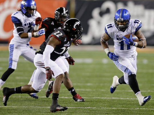 Memphis running back Sam Craft (11) runs against Cincinnati safety Zach Edwards (22) during the second half of an NCAA college football game, Saturday, Oct. 4, 2014, in Cincinnati. (AP Photo/Al Behrman)