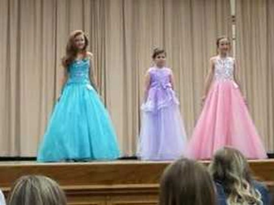 2018 Henderson County Fair Preteen Pageant contestants stand on stage at North Middle School.