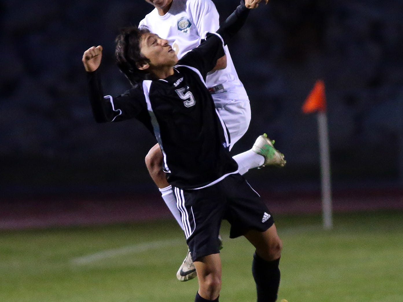 Desert Hot Springs' Pablo Minero (2, white) wins a header over an opponent from Yucca Valley in the first half of a boys' soccer game Tuesday in Desert Hot Springs. Crystal Chatham/ The Desert Sun