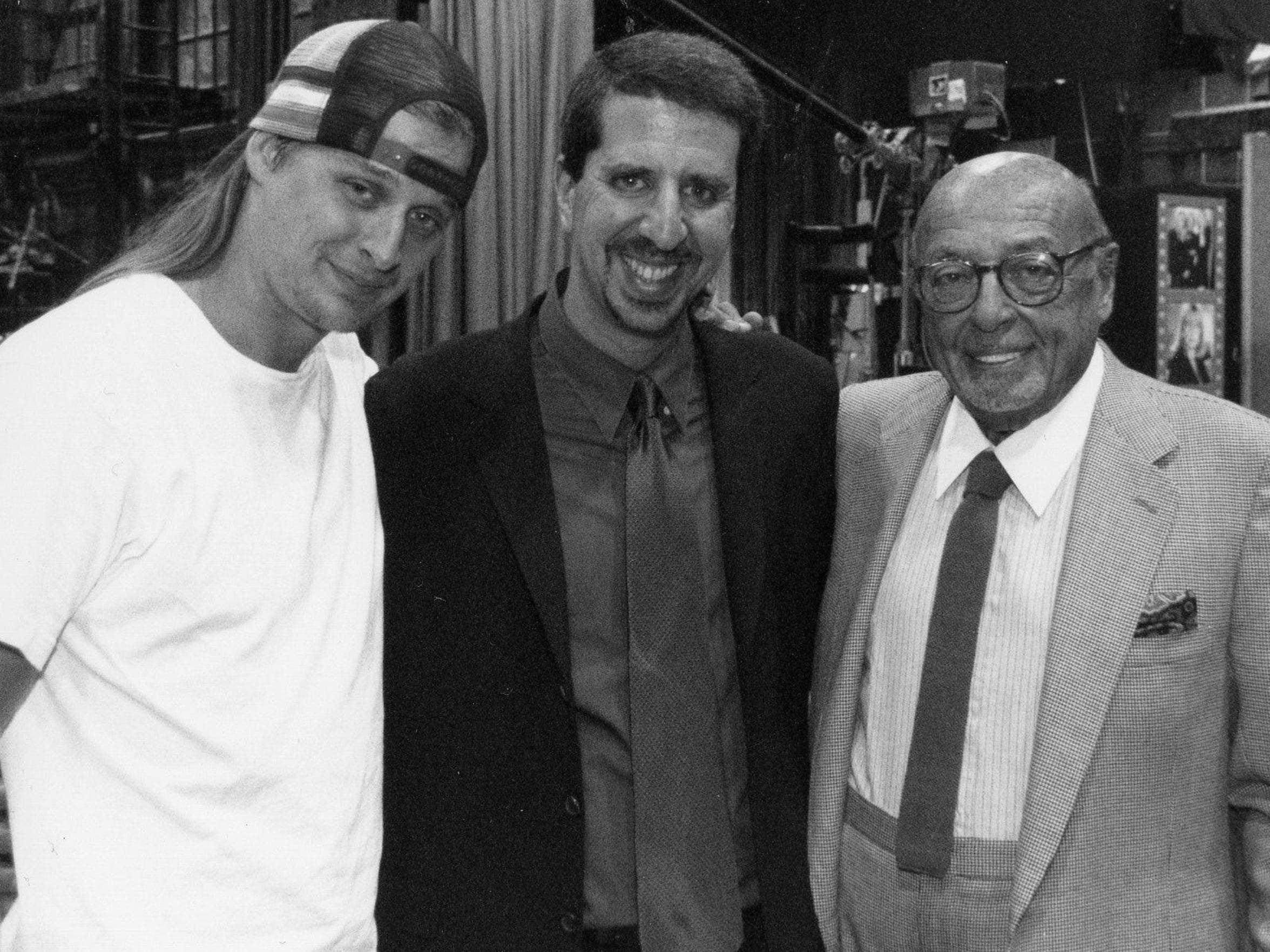 Kid Rock with Atlantic Records' Jason Flom, center,