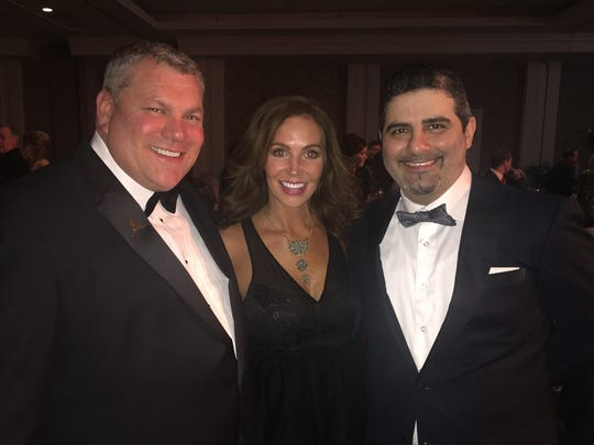Scott Barber, from left, Colleen Palmertree and Romeo Khazen attend the Liberty Bowl President's Gala last December at The Peabody. Barber, regional president for Caesars Entertainment, was elected 2016 AutoZone Liberty Bowl Festival Association president.