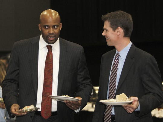 2011 flashback: Former head coach Cuonzo Martin talks with new head coach Paul Lusk at the Missouri State men's basketball banquet on Sunday, April 17, 2011. In Martin's remarks he said that Lusk is one of his best friends.