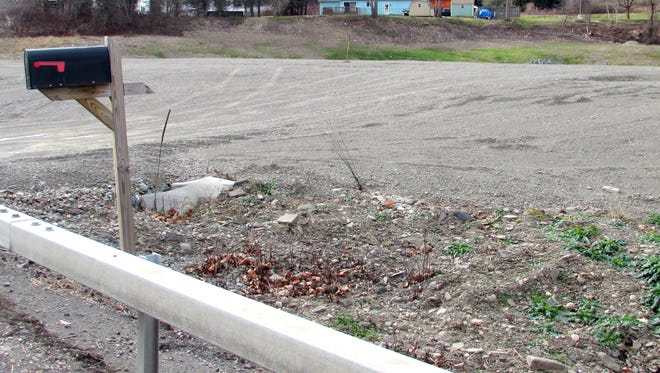 An empty lot and a mailbox are all the Village of Wellsburg have to show so far in its effort to build a new fire station.