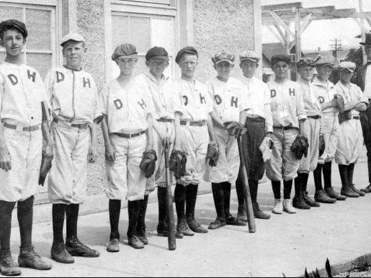 The school baseball team is shown in perhaps the late 1920s, though the date and identities are unknown. The photo is a postcard in the Murphy Givens Collection.