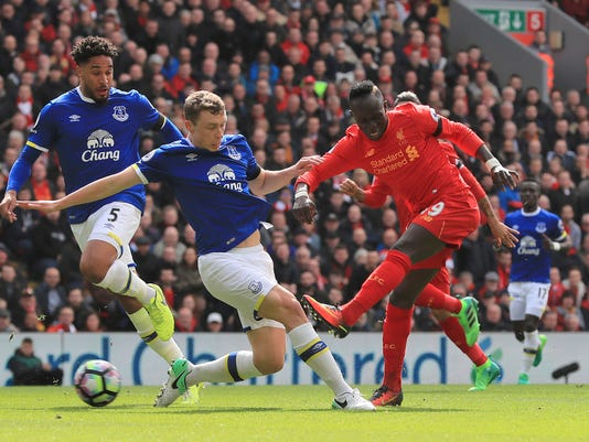 Liverpool's Sadio Mane, right, scores his side's first goal, during the English Premier League soccer match between Liverpool and Everton, at Anfield, in Liverpool, England, Saturday April 1, 2017. (Peter Byrne/PA via AP)