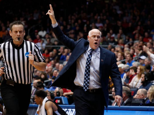 St. Bonaventure Bonnies head coach Mark Schmidt reacts to a play in the first half against the UCLA Bruins during the First Four of the 2018 NCAA Tournament at Dayton Arena on March 13, 2018.