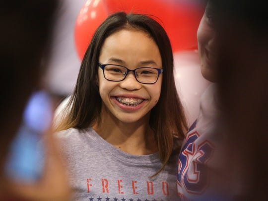 Morgan Hurd smiles for snapshots with friends and fans as she is welcomed back Wednesday at First State Gymnastics in Newark after winning the world championships in gymnastics late last week.