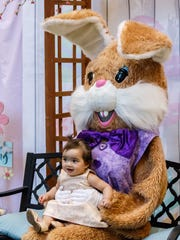 Nine-month-old Mia Granzow of Oconomowoc visits with the Easter Bunny at Center Court in Brookfield Square Mall on Monday, March 19, 2018.