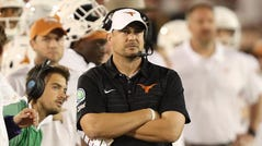 Texas coach Tom Herman stands on the sideline during