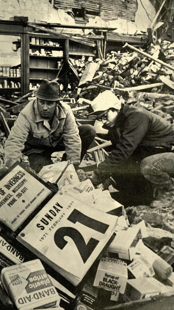 Johnny Ammons helps sift through Mr. Day's Drug Store rubble to find anything to salvage from the 1971 tornado.