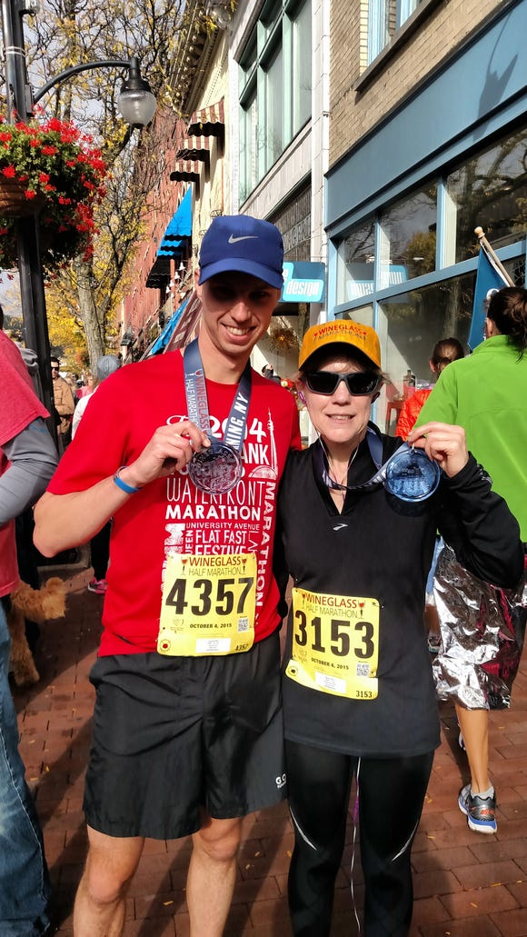 Traci and me with our medals after finishing the Wineglass Half Marathon.