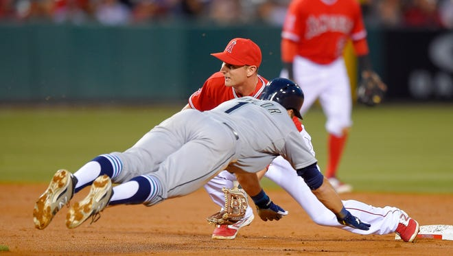 Seattle Mariners' Chris Taylor, left, steals second as Los Angeles Angels second baseman Johnny Giavotella takes a late throw during the third inning of a baseball game, Wednesday, May 6, 2015, in Anaheim, Calif.