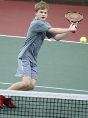 Kohler's Casey Johnson goes for a backhand during the WIAA Division 2 State Singles Championship match at Nielsen Tennis Stadium on Saturday.