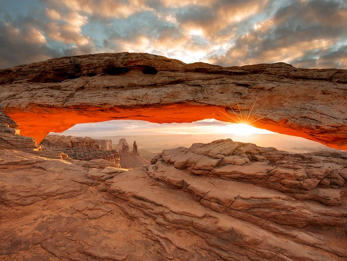 Morning magic: The rising sun shines through the Mesa Arch at Canyonlands National Park in Utah. The photo was submitted to USA TODAY via Your Take at yourtake.usatoday.com