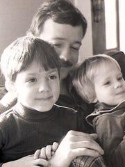 Roger Hartman holds his children Mogan (left) and Mandy