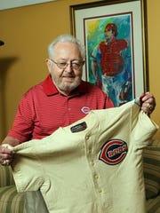Bernie Stowe with the uniform shirt he wore as a bat boy at the 1953 All-Star Game at Crosley Field.